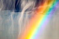 Close-up of hail shaft and rainbow