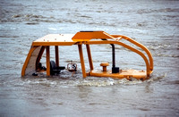 Bulldozer Submerged in Flood Waters