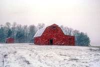 Farm and Red Barn in Heavy Snow