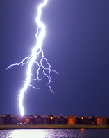 Lightning Bolting Striking Apartment Complex