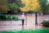 Man Observing Flash Flooding in Residential Neighborhood
