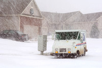 U.S. Postal Carrier Delivering Mail During Blizzard