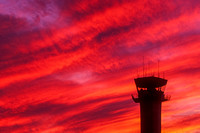 Airport Control Tower Backlit by Spectacular Sunset