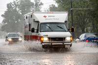 American Red Cross Truck Driving Through Flooded Street