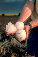 Man Holding Softball-Sized Hailstones