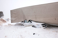 Car Crushed Beneath Semi-Truck During Snow Storm (Angle 2)