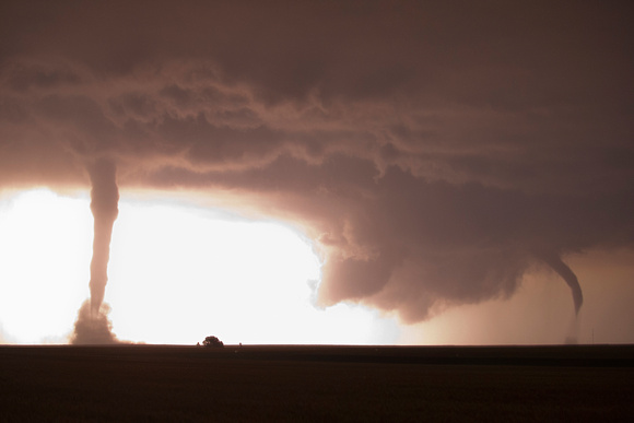 Twin Night Tornadoes Illuminated by Lightning