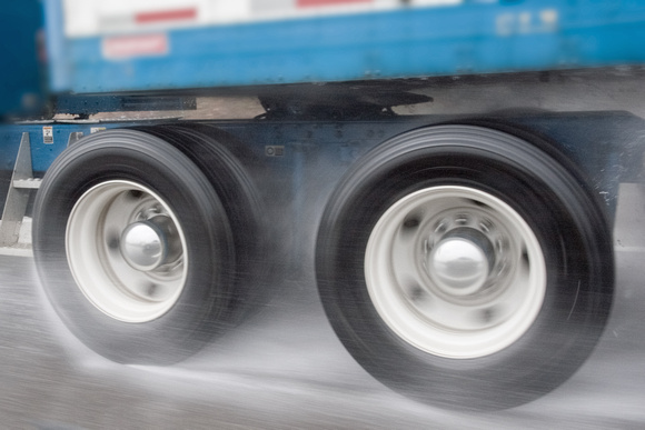 Speeding Truck Tires in Rain