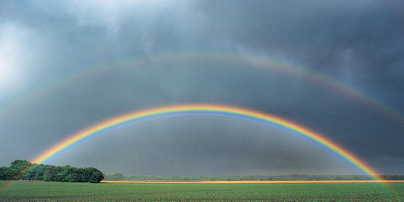 Double Rainbow Over Rural Landscape
