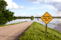 "Flooded Road With ""Impassable During High Water"" Sign"