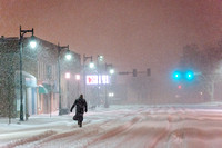 Lone Man Walking in Snow Storm at Night