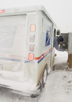 A U.S. Mail Carrier Struggling to Deliver Mail During Snow Storm