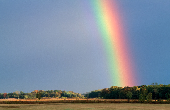 Rainbow Over Rural Landscape